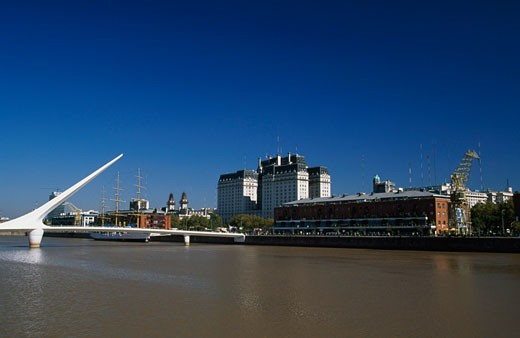 Buildings on the waterfront, Puente de la Mujer, Buenos Aires, Argentina : Stock Photo