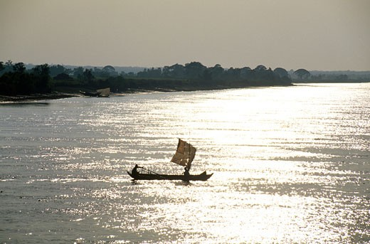 Silhouette of two people sitting in a boat, Ayeyarwady River, Myanmar : Stock Photo
