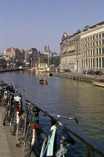 Stock Photo: 1344-137 Bicycles leaning against the railing along a canal, Rokin, Amsterdam, Netherlands