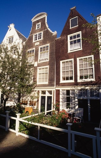 Stock Photo: 1344-150 Facade of townhouses in a row, Begijnhof, Amsterdam, Netherlands