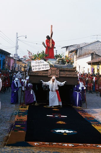 Group of people carrying a religious platform in a traditional festival, Holy Week, Antigua, Guatemala : Stock Photo