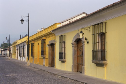 Houses in a row on a street, Antigua, Guatemala : Stock Photo