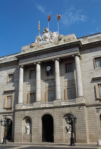 Low angle view of a government building, Casa de la Ciutat, Barcelona, Spain : Stock Photo