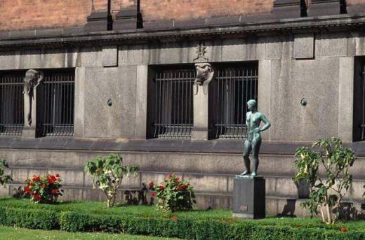 Statue in the courtyard of a museum, Ny Carlsberg Glyptotek, Copenhagen, Denmark : Stock Photo