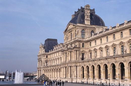 Facade of an art museum, Louvre, Paris, France : Stock Photo