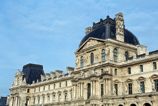 Low angle view of an art museum, Louvre, Paris, France : Stock Photo