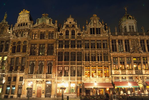 Low angle view of buildings lit up at night, Grand Place, Brussels, Belgium : Stock Photo