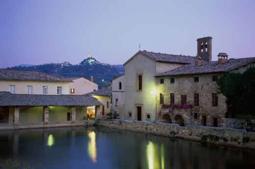 Reflection of buildings in water, Roman Baths, Bagno Vignoni, Tuscany, Italy : Stock Photo