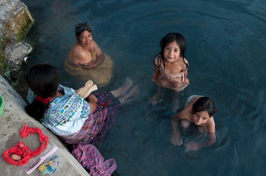 High angle view of people bathing in a pond, Totonicapan, Guatemala : Stock Photo