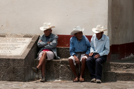 Three senior men sitting together, Santiago Atitlan, Lake Atitlan, Guatemala : Stock Photo