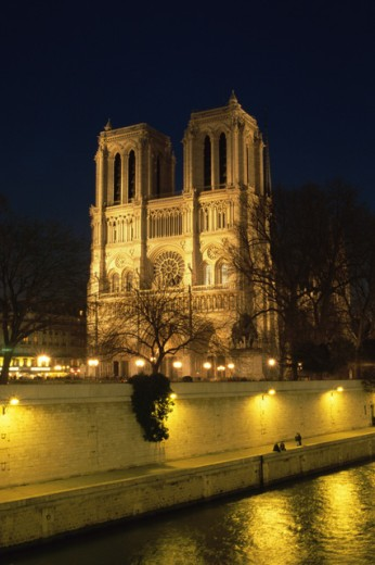 Stock Photo: 1345-627 Low angle view of a cathedral lit up at night, Notre Dame, Paris, France