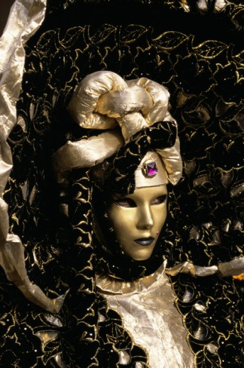 Close-up of a person wearing a masquerade mask, Venice, Italy : Stock Photo