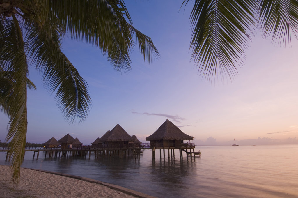 Stock Photo: 1345R-1312 Stilt houses at a tourist resort on the beach, Hotel Kia Ora, Rangiroa, Tuamotu Archipelago, French Polynesia