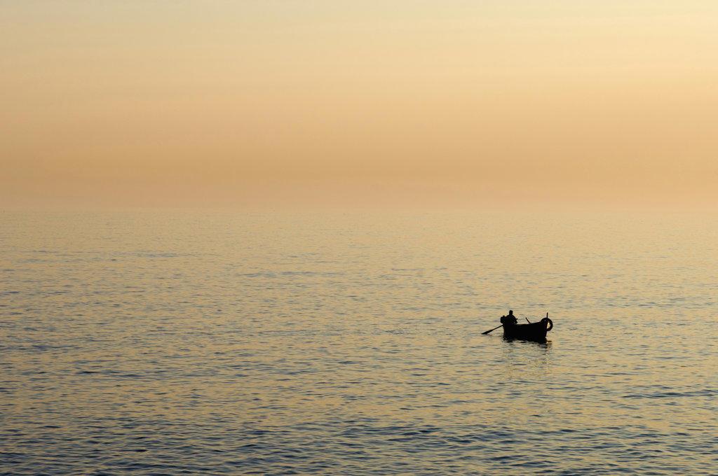Silhouette of a boat in the sea, Camogli, Liguria, Italy : Stock Photo