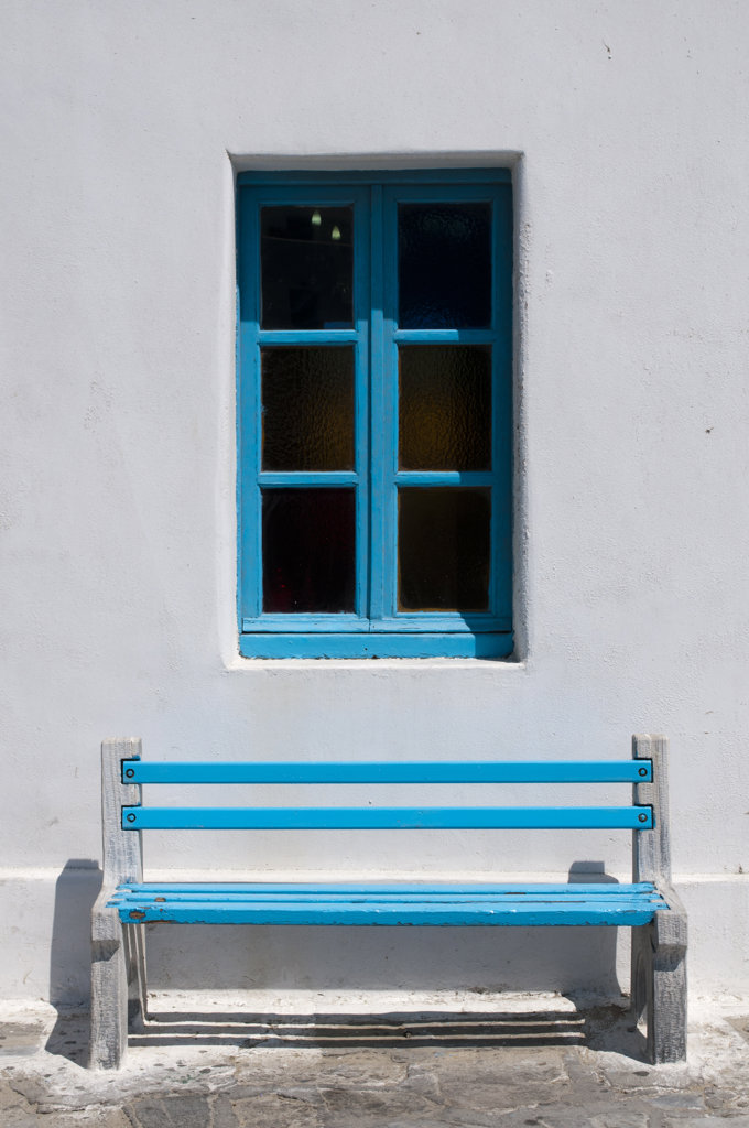 Bench in front of a window, Mykonos Town, Mykonos, Cyclades Islands, Greece : Stock Photo