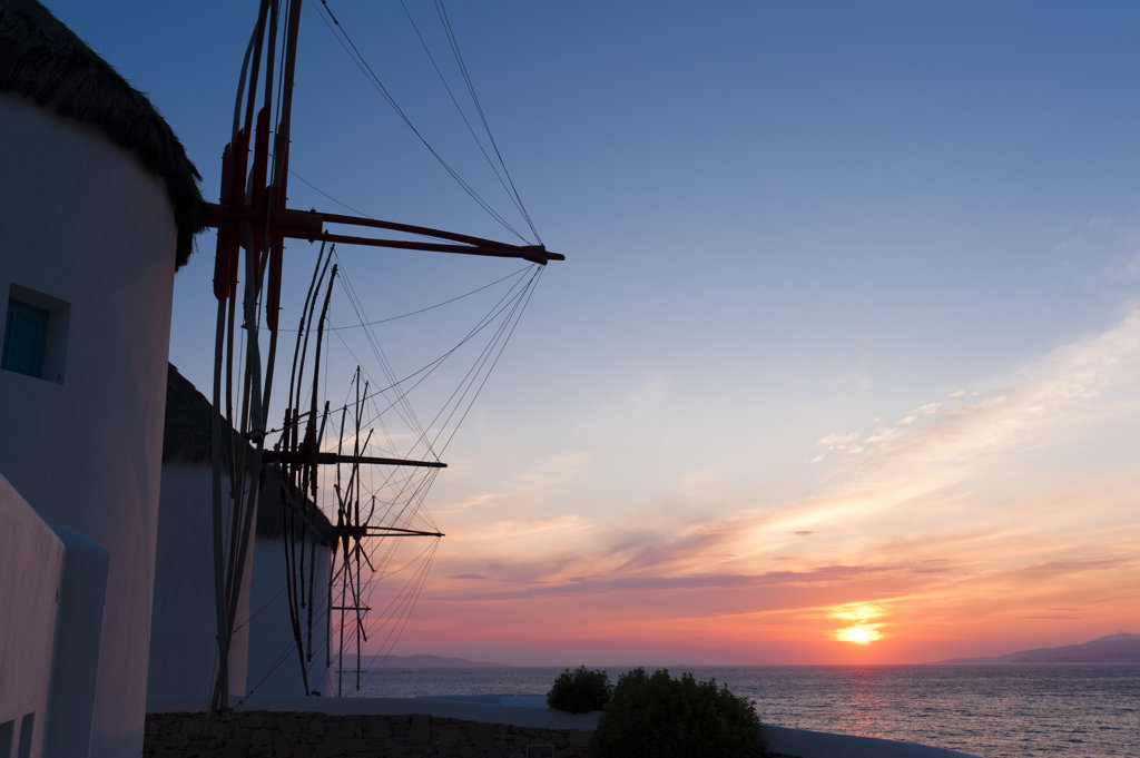 Traditional windmill at sunset, Mykonos Town, Mykonos, Cyclades Islands, Greece : Stock Photo