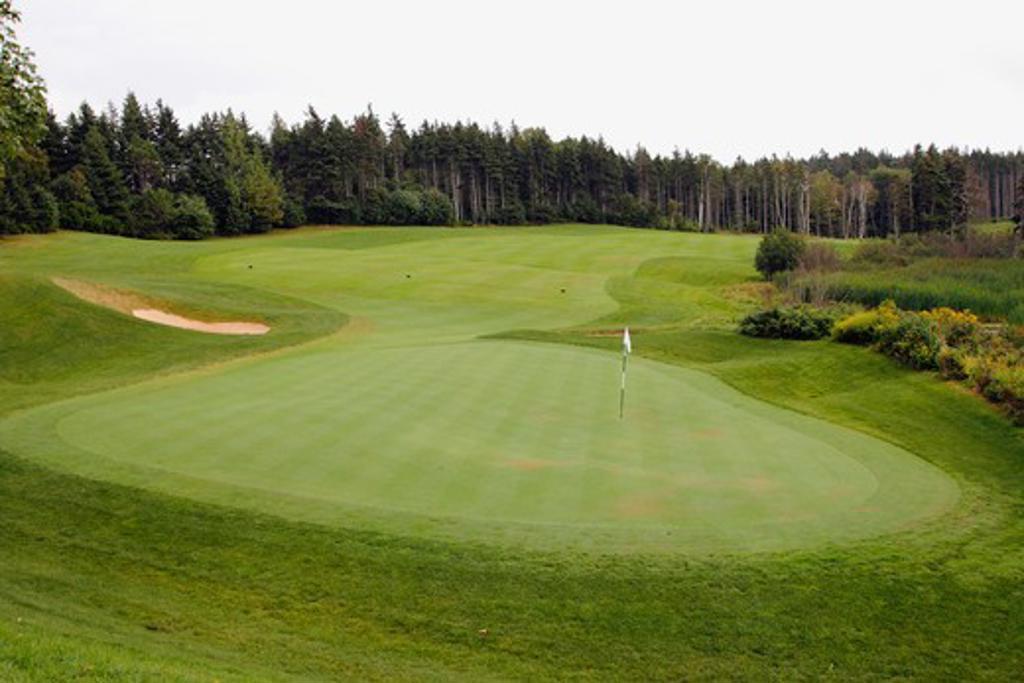 Golf flag in a golf course, Green Gables Golf Course, Prince Edward Island, Canada : Stock Photo