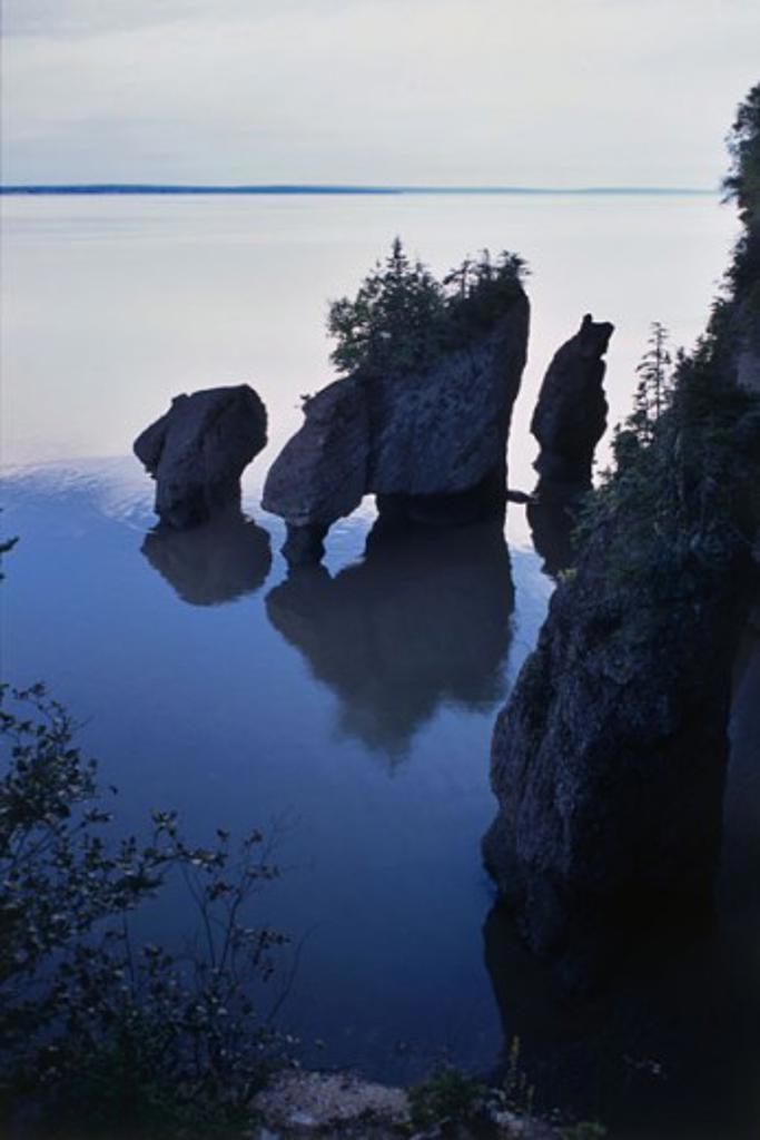 Stock Photo: 1346-375 Reflection of rocks in water, Hopewell Rocks, New Brunswick, Canada