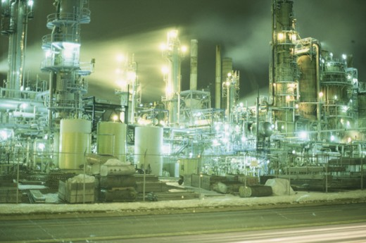 Oil industry lit up at night : Stock Photo