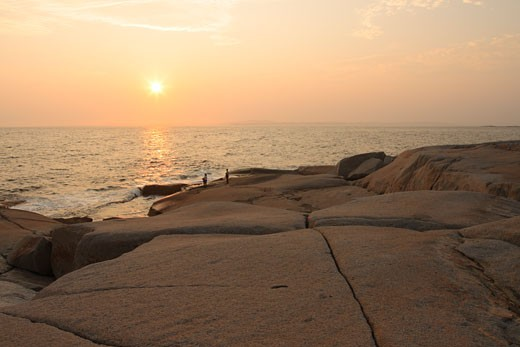 Stock Photo: 1346-819 Sunset over the ocean, Peggy's Cove, Nova Scotia, Canada
