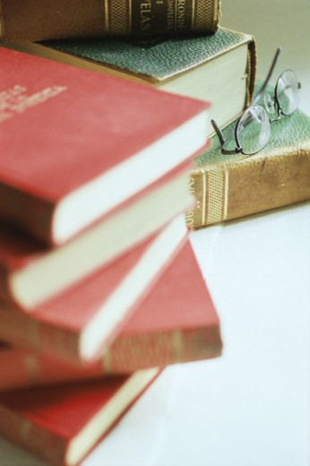Close-up of two stacks of books with eyeglasses : Stock Photo