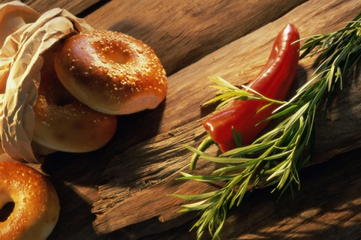 High angle view of bagels and chili peppers : Stock Photo