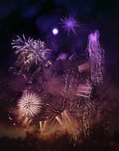 Fireworks display at night in a city : Stock Photo