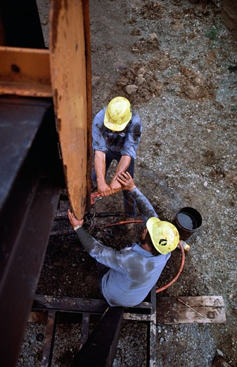 High angle view of workers drilling for oil : Stock Photo