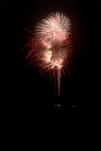 Low angle view of firework display at night : Stock Photo