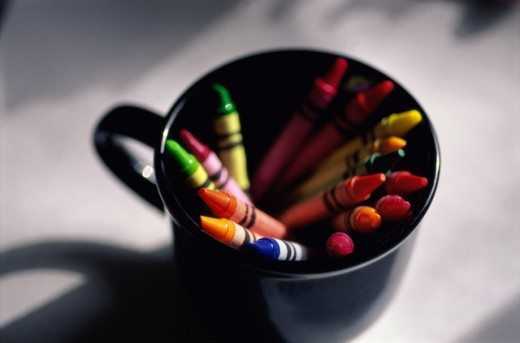 Close-up of crayons in a mug : Stock Photo
