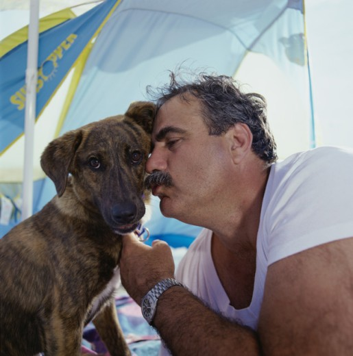 Stock Photo: 1368-162 Close-up of a mature man kissing his dog