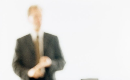Stock Photo: 1368-201 Blurred view of a businessman standing