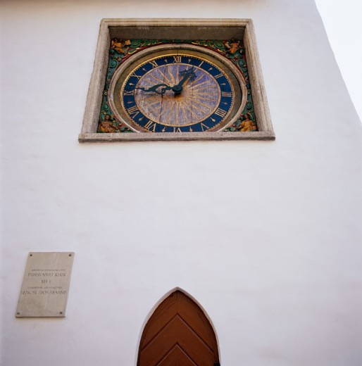 Stock Photo: 1368-231 Clock on a wall, Tallinn, Estonia