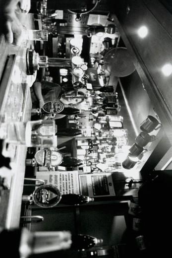 Female bartender serving a drink : Stock Photo