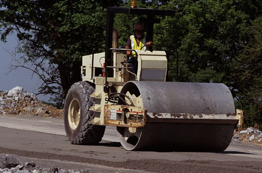 Steamroller at a road construction site : Stock Photo