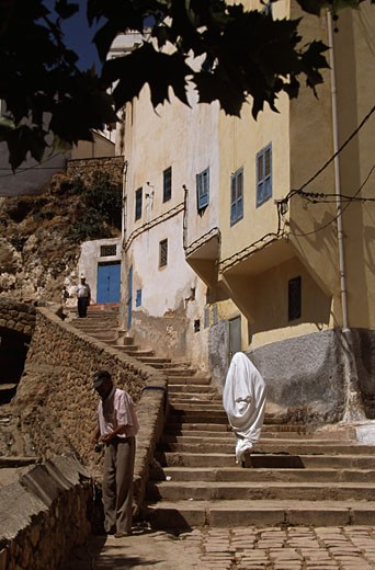 Rear view of a woman moving up on steps, Bitalil, Morocco : Stock Photo