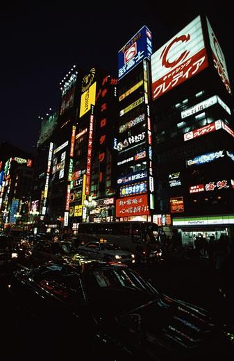 Buildings lit up at night in a city, Shinjuku, Tokyo, Japan : Stock Photo