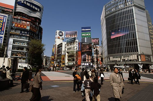 Stock Photo: 1370-42169 Group of people walking in front of buildings in a city, Shibuya, Tokyo, Japan