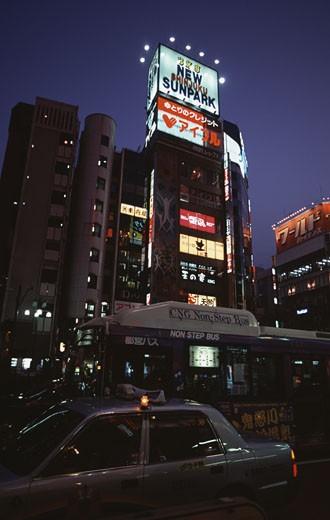 Stock Photo: 1370-42207 Buildings lit up at night in a city, Shinjuku, Tokyo, Japan