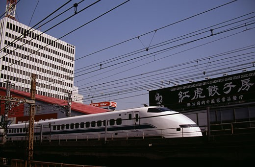 Bullet train in front of buildings, Tokyo, Japan : Stock Photo