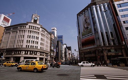 Cars crossing an intersection, Wako Department Store, Ginza, Tokyo, Japan : Stock Photo