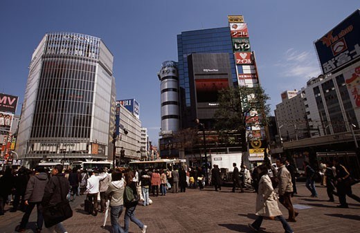 Group of people in front of buildings in a city, Shibuya, Tokyo, Japan : Stock Photo
