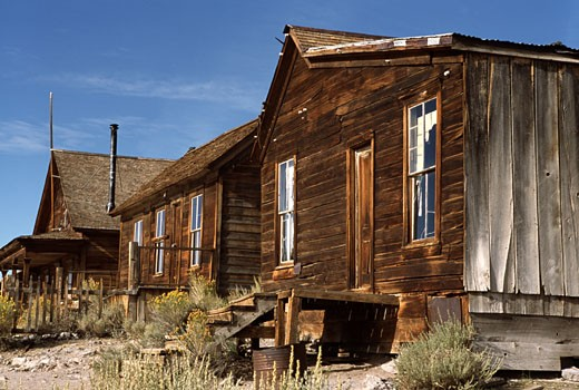 Abandoned wooden buildings in a town, Bodie State Historic Park, California, USA : Stock Photo