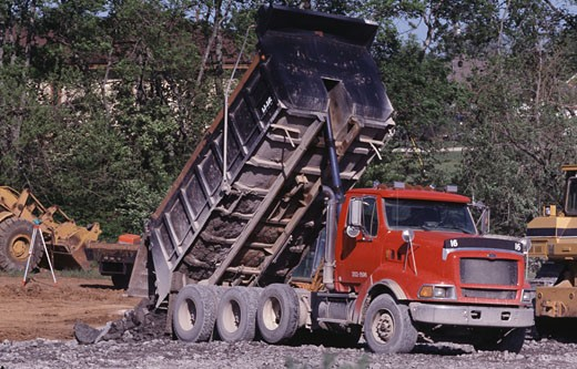 Dump truck at a road construction site : Stock Photo