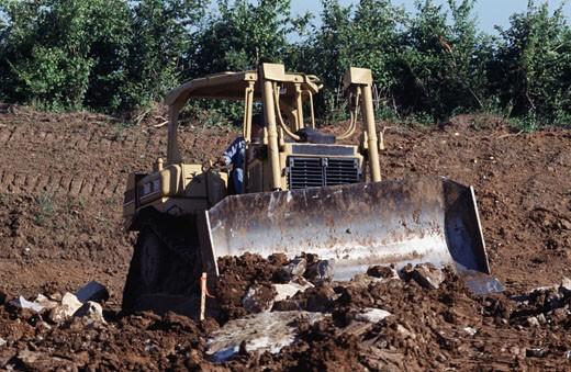 Bulldozer at a construction site : Stock Photo