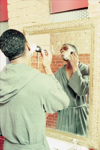 Stock Photo: 1371-125 Rear view of a young man applying shaving cream to his face