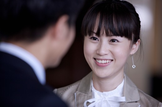 Young woman staring and smiling happily : Stock Photo