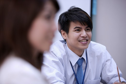 Stock Photo: 1397R-69172 Young man looking away and smiling happily