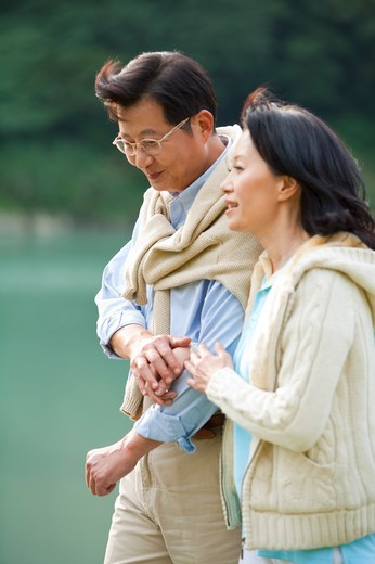 Couple, Couple walking and talking near the lake : Stock Photo