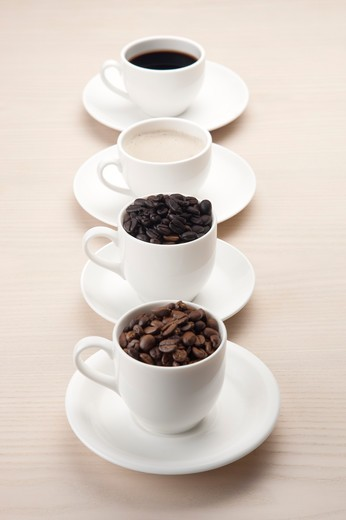 Stock Photo: 1397R-69324 Coffee, Coffee Bean, Close-up of coffee and coffee beans on four cups